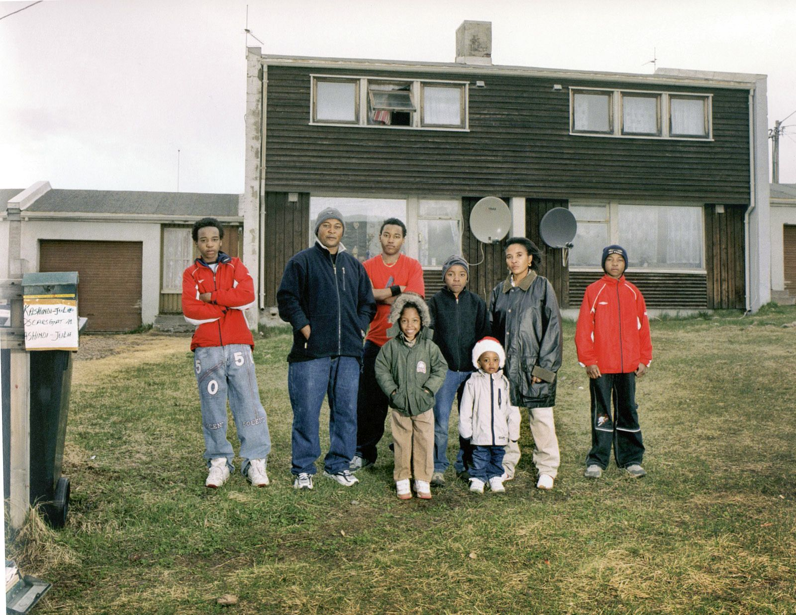 The Spirit of place? The Wilondja family in front of their house in Vadsø, northern Norway.