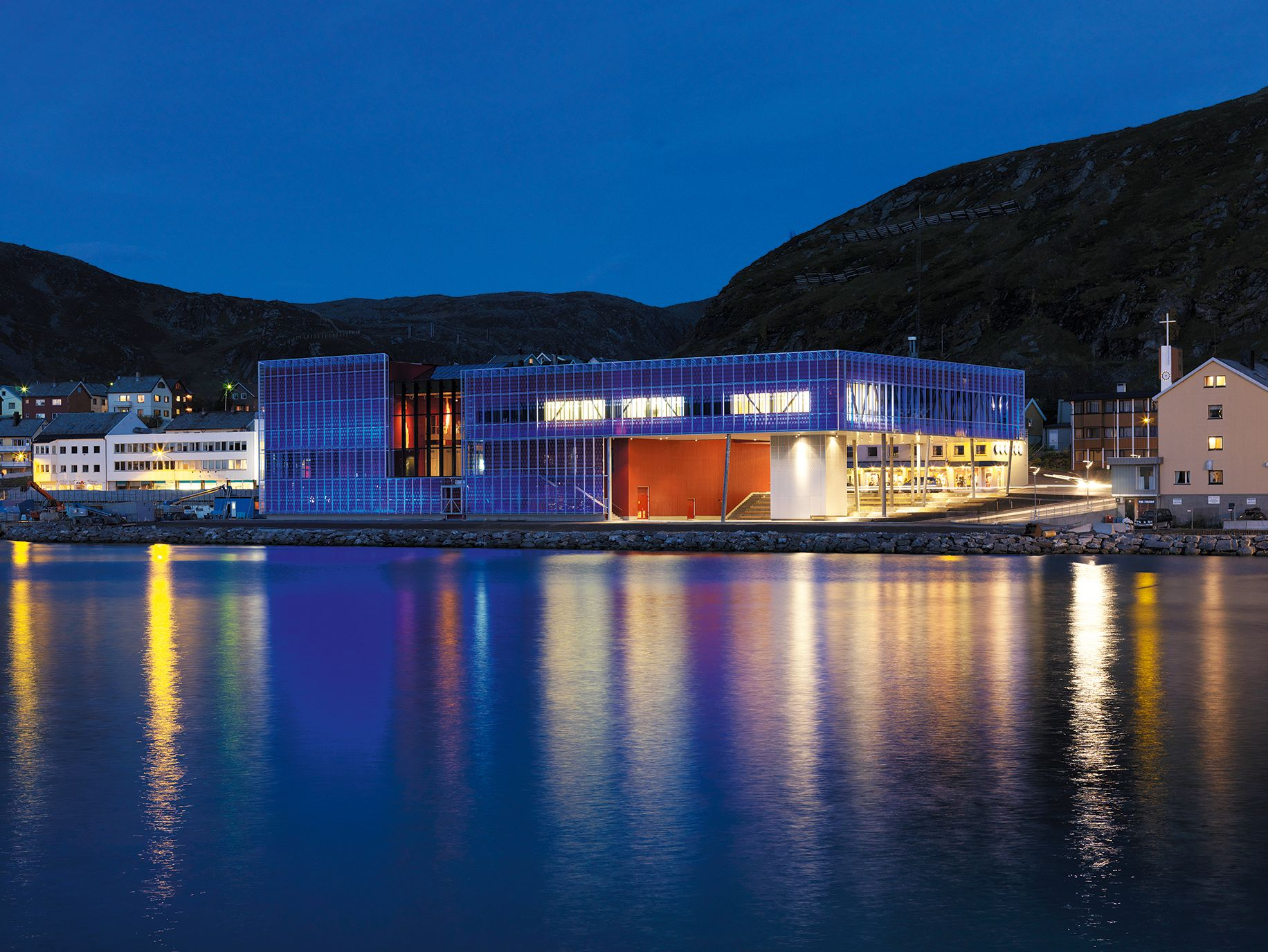 Arctic Culture Centre, Hammerfest. A-lab AS, 2009. The outer glass skin of the building is lit with LED lights that change colour. Photo: Jiri Havran